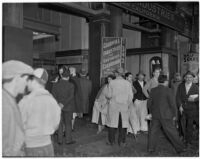 Crowd outside the Goodwill Industries premises in the Baker Block building, picture taken before a fire occurred at the site on January 14, 1938