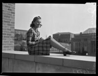 Janice Lipking, a Zeta Tau Alpha sorority sister at UCLA, posing on a ledge, Los Angeles, late 1930s