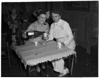 Mrs. Harry E. Willis pouring a beverage for Mrs. Howard M. Jay during a women's club picnic meeting at the home of Mrs. Jay, Los Angeles, July 10, 1939