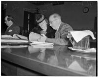 Dr. George K. Dazey and his third wife, Dorcas Dazey, at the trial where Dr. Dazey is accused of the murder of his second wife, Doris S. Dazey, Los Angeles, 1939-1940