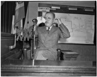 Dr. George K. Dazey on the witness stand at the trial where he is accused of the murder of his second wife, Doris S. Dazey, Los Angeles, 1939-1940