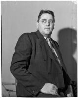 Ned Cronin, Los Angeles Daily News sports editor, posing in a chair, Los Angeles, January 1940