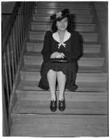 Mrs. Bessie H. Cooper, prominent clubwoman, posing on a staircase, Los Angeles, 1940s