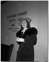 Mrs. Ella Peskay standing in a courtroom, Los Angeles