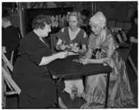 Mrs. Ellwood K. Lightholder, Mrs. Henry H. Robinson, and Mrs. John H. Harris, clubwomen playing cards, Los Angeles, circa 1940