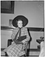 Mrs. Mary Dell Eaton posing in a chair, Los Angeles