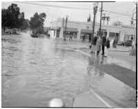 Group gathered at flooded streets caused by heavy rainstorms, January 1940