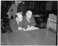 Chief liquor control officer Merle Templeton with his attorney Richard H. Sampson at the liquor license bribe trial, Oct 1939 - May 1940