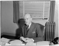Judge Stanley Moffatt at his desk, Huntington Park, 1930-1950