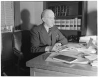 Judge Stanley Moffatt at his desk, Huntington Park