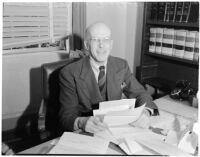 Judge Stanley Moffatt at his desk, Huntington Park