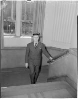 Judge Stanley Moffatt posing at the bottom of a staircase, Huntington Park, 1930-1950