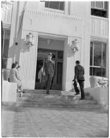 Judge Stanley Moffatt walking down the courthouse steps, Huntington Park