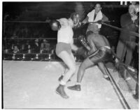 Ceferino Garcia, champion boxer from the Philippines, taking a punch during a fight, Los Angeles, circa 1938