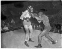 Ceferino Garcia, champion boxer from the Philippines, landing a punch, Los Angeles, circa 1938
