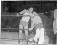Ceferino Garcia, champion boxer from the Philippines, with his trainer in the ring, Los Angeles, circa 1938