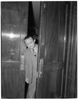 Maier (Maxie) Joskowitz, cafe owner and confessed front man in a liquor license pay-off plot, looking through a doorway during the trial, Oct. 1939-May 1940