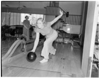 Mrs. Argyle H. Gudie bowling during the Woman's Field Day Challenge as event chairman Mrs. William E. Beatty looks on, May 1939