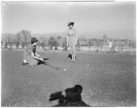 Mrs. Paul S. Sweeny and Bess Marcus playing golf, Los Angeles, 1940s