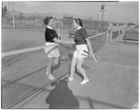 Mrs. Frances Hjelte and Mrs. Virginia Petticord shaking hands on the tennis court, Los Angeles