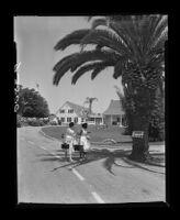 Ventura School for Girls parolees leaving the school's grounds, 1955.