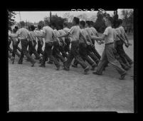 Residents of Fred C. Nelles School for Boys march to work, 1955.