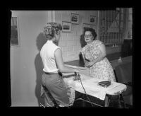 Helen Joyce, psychiatric social worker, visits inmate in girls' ward at California Youth Authority, Los Angeles, 1955