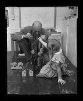 Child psychiatrist Dr. M. B. Durfee and a girl during play therapy, Pasadena, 1955