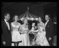 Santa Anita Derby Ball attendees, from left, Mr. and Mrs. Charles Shoemaker, Mrs. Spencer Tracy, and Mr. and Mrs. Lawrence Bird, 1956.