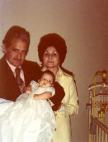 Mr. and Mrs. Guardia with grandchild