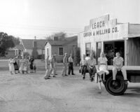 Generations of the Leach family in front of their Grain and Milling building, Downey, 1956