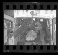 Van in Santo Domingo, Dominican Republic during reporter Ruben Salazar's assignment to interview junta troops, 1965.