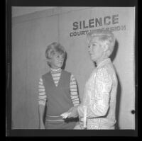Friends of Elaine Kirschke waiting to testify at the trial of her husband, Jack Kirschke, who was accused of killing her, Los Angeles, 1967