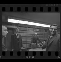 Jack Kirschke in a law office with threex other men, Los Angeles, 1967