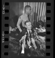 Jack Kirschke talking to journalists at the time of his murder trial, Los Angeles, 1967