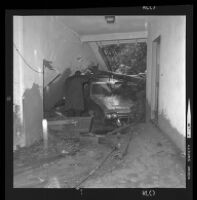 Mud and car in garage or living room after mudslide, Los Angeles, 1969