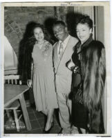 Abie Robinson, Los Angeles Sentinel reporter and editor, with two unidentified women, Los Angeles, 1940s