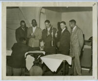 Norman O. Houston, Edwin Jefferson, and Ivan J. Johnson III at a golf awards ceremony, Los Angeles, 1940s
