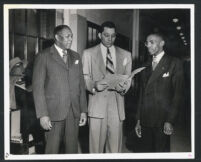 Walter L. Gordon, Jr. with two clients after a trial, Los Angeles, 1940s