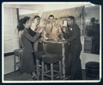 Informal gathering at the bar in Walter Gordon's office, Los Angeles, 1940s