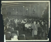 Large, racially-mixed audience in an auditorium, Los Angeles, 1950s
