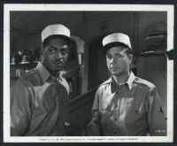 Kenny Washington and Dick Powell in a still from Rogues' Regiment
