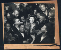 Marva Louis in a crowd of African American sailors, Los Angeles, 1940s