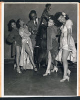 Showgirls with a musician, Los Angeles, 1940s