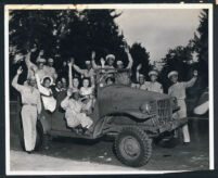 Ethel (Sissle) Gordon with soldiers and civilian women, Los Angeles, 1940s