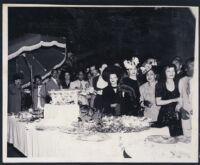 William Goodloe, Juanita Goodloe and others at a garden party, Los Angeles, 1940s