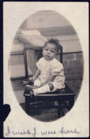 Postcard of baby seated in chair, New Orleans, 1888(?)