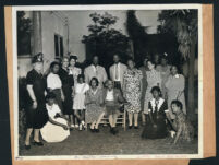 Esther Beck and her mother, Jennie S. Bruington posing with a group in a yard, Los Angeles, 1930s?