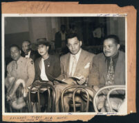 Mr. and Mrs. Leonard Tibbs, Walter L. Gordon, Jr., James Garcia and Floyd Snelson at a fashion show, Los Angeles, 1940s