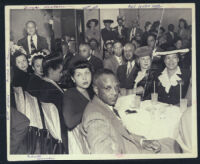 Well-dressed group dining out, Los Angeles, 1940s